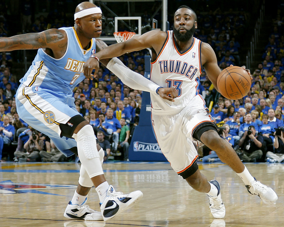 Photo - Oklahoma City's James Harden gets past Denver's Al Harrington during the first round NBA Playoff basketball game between the Thunder and the Nuggets at OKC Arena in downtown Oklahoma City on Wednesday, April 20, 2011. The Thunder beat the Nuggets 106-89 and lead the series 2-0. Photo by John Clanton, The Oklahoman