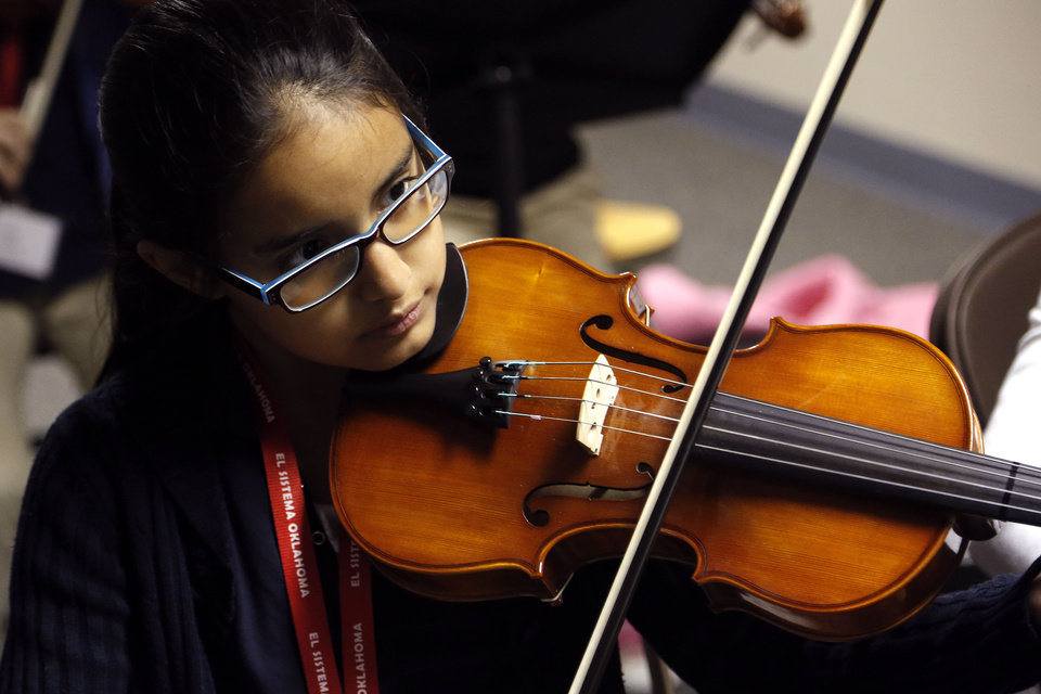Photo - Linwood Elementary School fourth- grader Linda Barrios, 9, plays the viola during a recent afternoon practice session of El Sistema Oklahoma.   SARAH PHIPPS - The Oklahoman