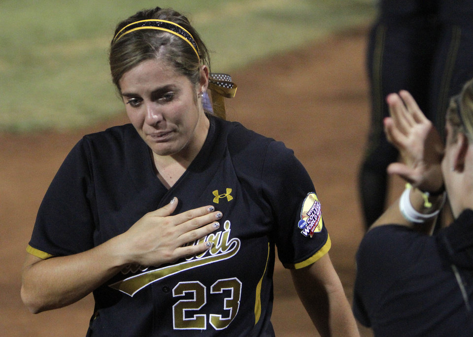 Missouri's Catherine Lee (23) reacts after losing to Baylor during the Women's College World Series game between Baylor and Missouri at the ASA Hall of Fame Stadium in Oklahoma City, Sunday, June 5, 2011. Photo by Sarah Phipps, The Oklahoman