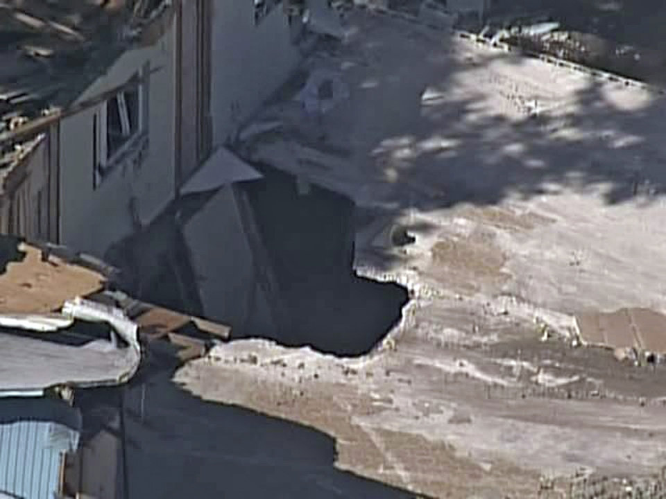 Photo - In this video image provided by ABC Action News-WFTS TV, shows an aerial photo of a sinkhole Monday, Mar. 4, 2013, in Seffner, Fla. The hole opened up underneath a bedroom late Thursday evening and swallowed Jeffrey Bush in Seffner, Fla. (AP Photo/ABC Action News-WFTS TV)