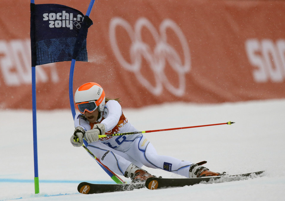 Photo - Sweden's Frida Hansdotter passes a gate in the first run of the women's giant slalom at the Sochi 2014 Winter Olympics, Tuesday, Feb. 18, 2014, in Krasnaya Polyana, Russia.(AP Photo/Luca Bruno)