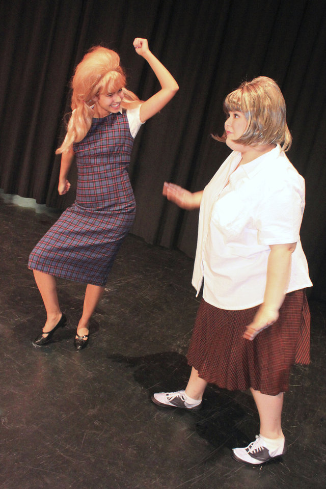 """Brooke Bradley, as Penny, and Alyssa Boston, as Tracy, rehearse for the Harding Fine Arts Academy drama department production of """"Hairspray."""" Photo provided by Harding Fine Arts Academy"""