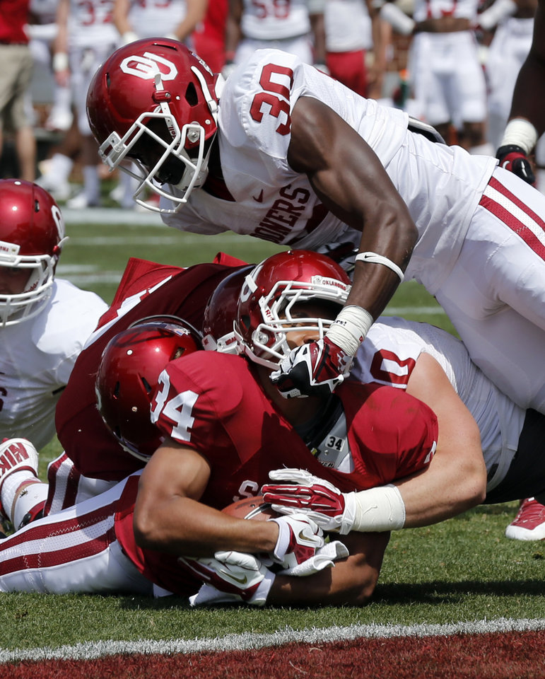 Photo - Daniel  Brooks (34) carries to the one as Thaddeus LaGrone (30) gives a shove during the Spring College Football Game of the University of Oklahoma Sooners (OU) at Gaylord Family-Oklahoma Memorial Stadium in Norman, Okla., on Saturday, April 12, 2014.  Photo by Steve Sisney, The Oklahoman