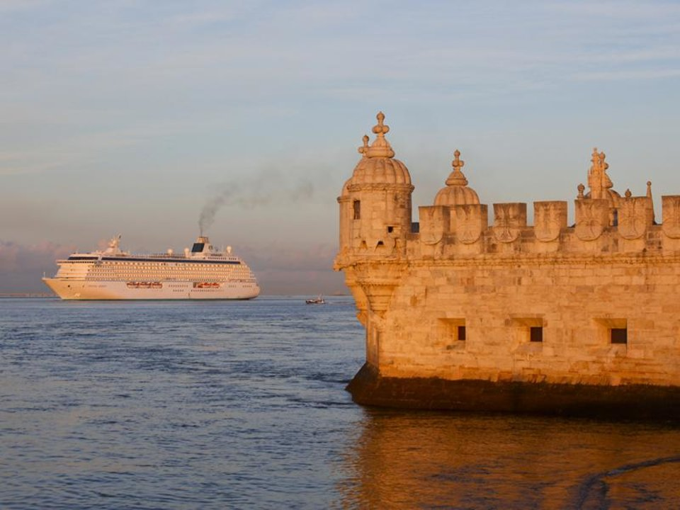 Photo - This undated photo provided by Crystal Cruises shows the luxury ship Crystal Serenity in the waters off of Lisbon, Portugal. A cruise on Serenity can be combined with bike tours in various ports that offer passengers an active way to experience the destination. (AP Photo/Crystal Cruises)