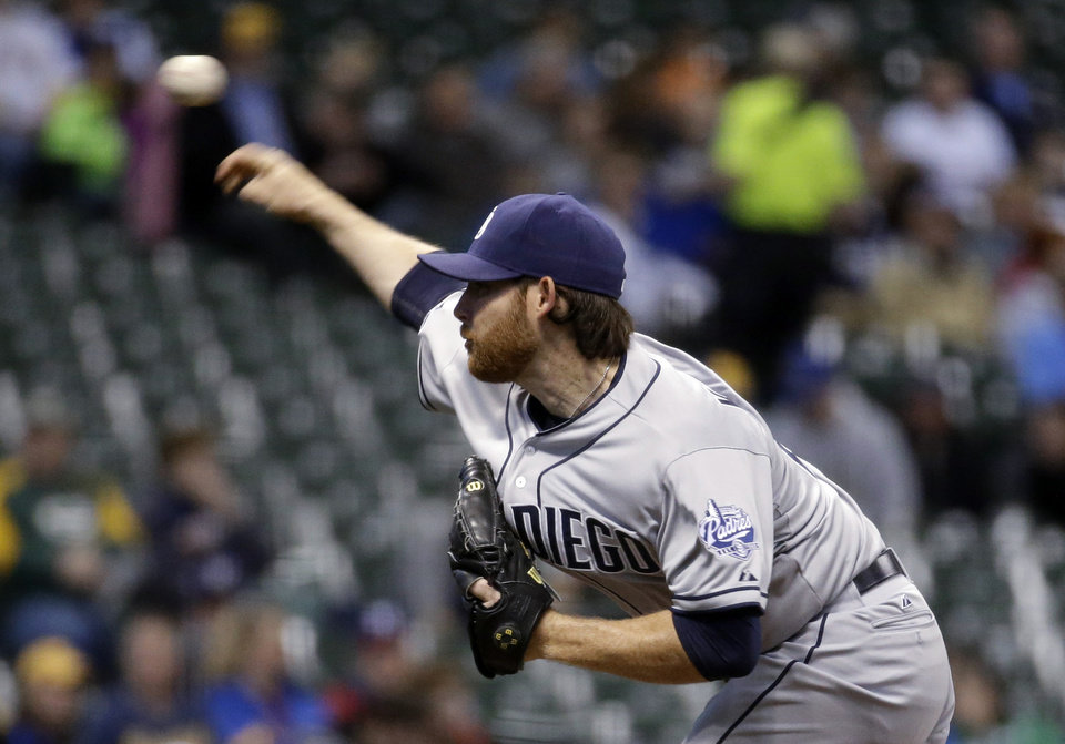 Photo - San Diego Padres starting pitcher Ian Kennedy throws during the first inning of a baseball game against the Milwaukee Brewers on Tuesday, April 22, 2014, in Milwaukee. (AP Photo/Morry Gash)