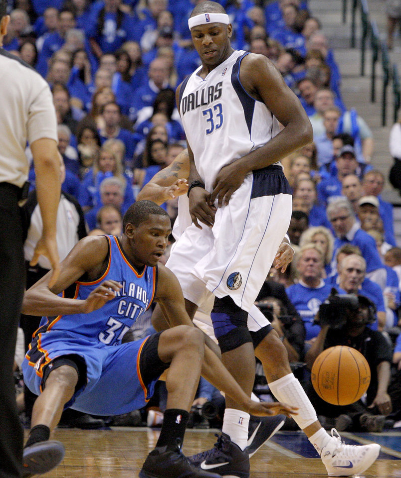 Oklahoma City's Kevin Durant (35) falls down after running into Brendan Haywood (33) of Dallas during game 1 of the Western Conference Finals in the NBA basketball playoffs between the Dallas Mavericks and the Oklahoma City Thunder at American Airlines Center in Dallas, Tuesday, May 17, 2011. Photo by Bryan Terry, The Oklahoman