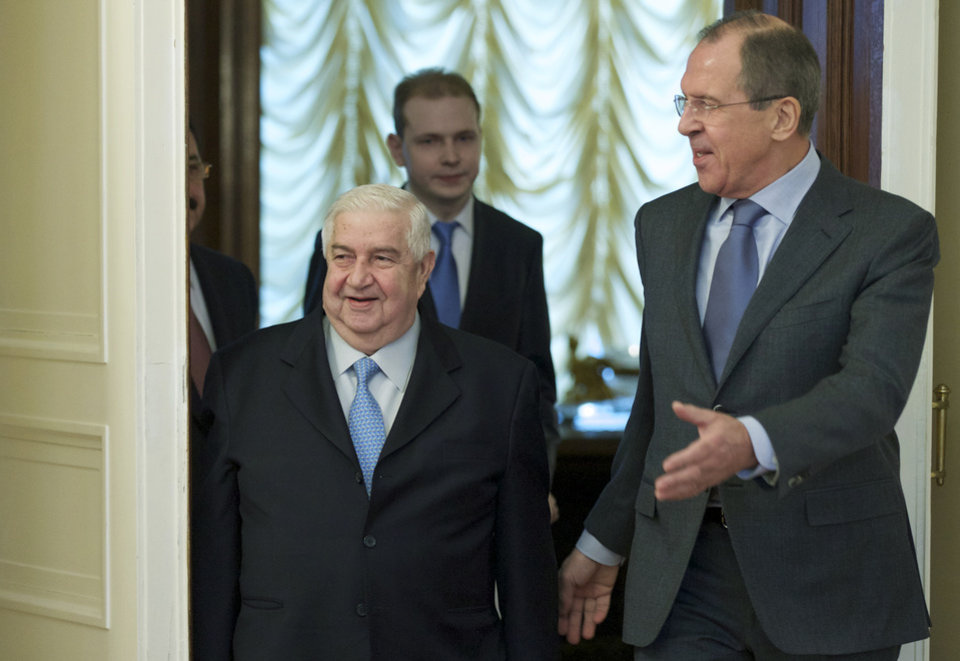 Photo - Russian Foreign Minister Sergey Lavrov, right, and his Syrian counterpart Walid al-Moallem arrive for talks in Moscow, Russia, on Friday, Jan. 17, 2014. Syria's Foreign Minister said Friday that his country is prepared to implement a cease-fire in the war-torn city of Aleppo and exchange detainees with the country's opposition forces as confidence building measures ahead of a peace conference opening next week in Switzerland. (AP Photo/Ivan Sekretarev)