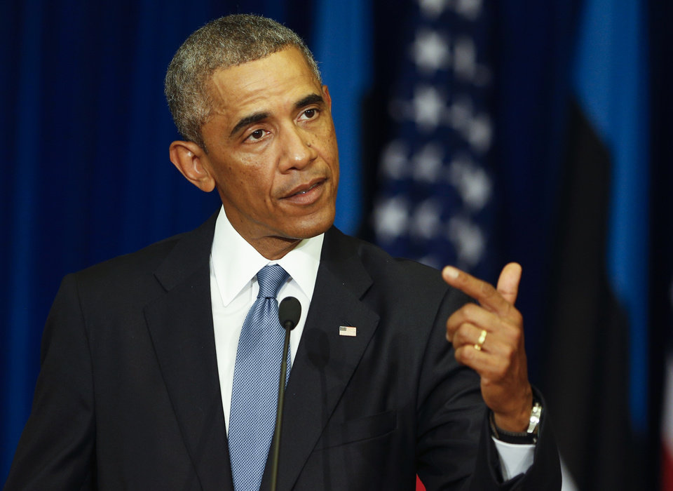 Photo - U.S. President Barack Obama gestures while speaking during his and Estonian President Toomas Hendrik Ilves's news conference at the Bank of Estonia in Tallinn, Estonia, Wednesday, Sept. 3, 2014. Wednesday's statement came as U.S. President Barack Obama arrived in Estonia in a show of solidarity with NATO allies who fear they could be the next target of Russia's aggression. (AP Photo/Mindaugas Kulbis)