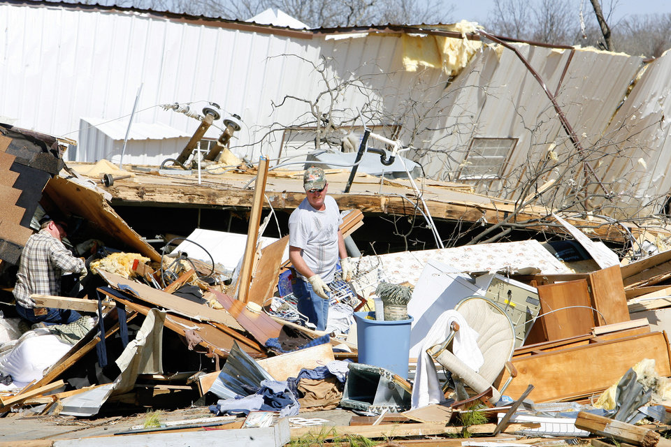 Roger Jones, right, gets help searching the debris of his mobile home from his nephew Josh Jones, left, on Newport Road in Lone Grove, Wednesday, Feb. 11, 2009. BY PAUL B. SOUTHERLAND, THE OKLAHOMAN