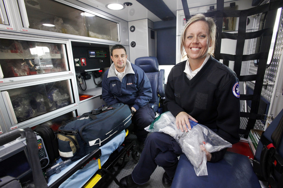 Husband and wife EMSA employees Tyler and Angi Whitmire inside their ambulance, unit 94, in Oklahoma City Thursday, Dec. 22, 2011.  Photo by Paul B. Southerland, The Oklahoman