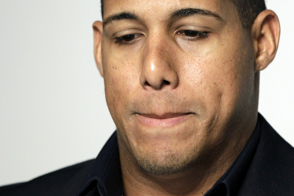 Photo -   Toronto Blue Jays' Yunel Escobar pauses during a news conference at Yankee Stadium in New York, Tuesday, Sept. 18, 2012. Escobar was suspended for three games Tuesday by the Blue Jays for wearing eye-black displaying a homophobic slur written in Spanish during last Saturday's game against the Boston Red Sox. (AP Photo/Kathy Willens)