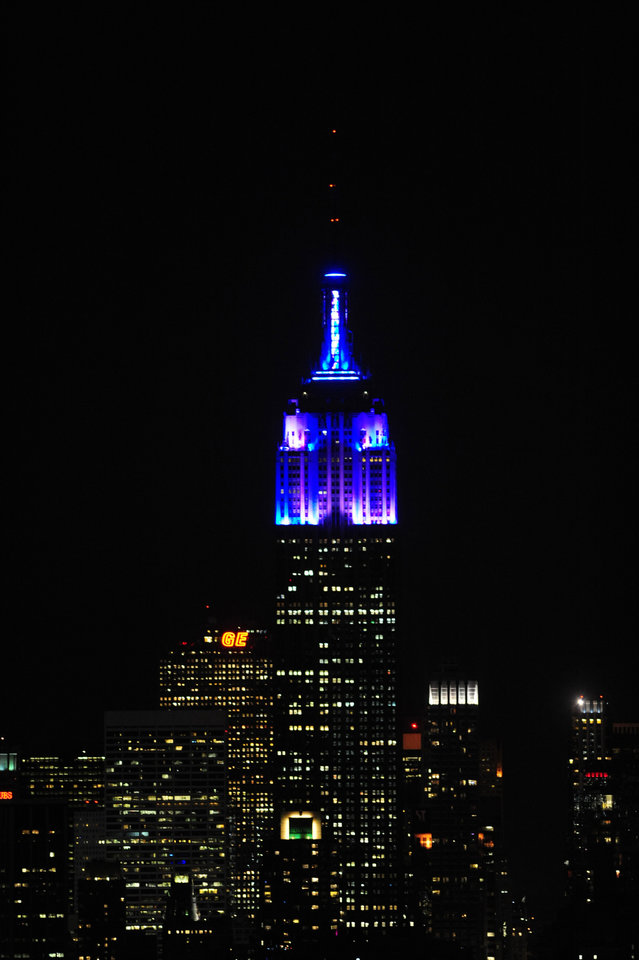 Photo -   In this Nov. 26, 2012, photo provided by the Empire State Building, the top floors of New York's Empire State Building are lit in blue and white light after being switched on by R&B star Alicia Keys. The landmark boasts a new LED lighting system with a palette of more than 16 million colors in limitless combinations, including ripples, sparkles, chasers, sweeps, strobes and bursts. The old lights came in only 10 colors. (AP Photo/Empire State Building, Bryan Smith)