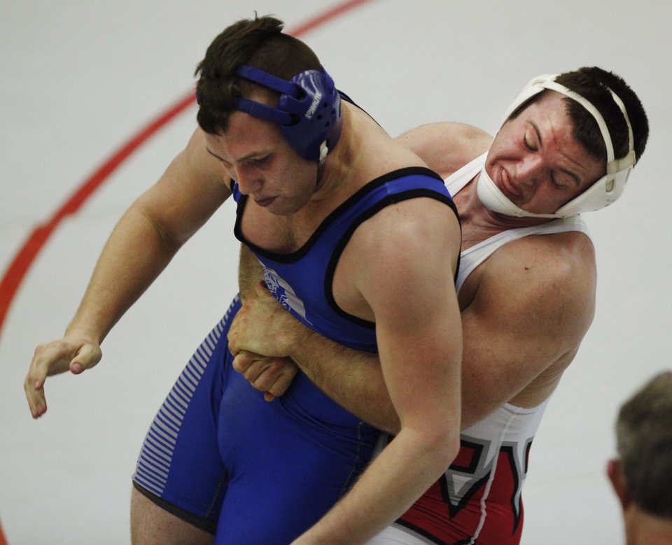 Photo - Weatherford's Jacob Hoffman (white) and Glencoe's Bryce Folkerts (blue) wrestle in the 195 pound match at the 4A West Regional wrestling championship in Harrah on Saturday, Feb. 22, 2014. Weatherford's Jacob Hoffman defeated Glencoe's Bryce Folkerts to advance to state. Photo by KT King, The Oklahoman