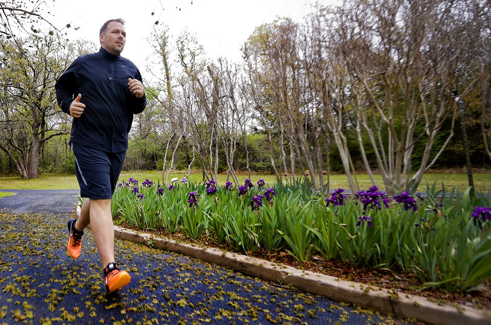 "Photo -  David Brown exercises April 21 at E.C. Hafer Park in Edmond as he prepares to run his first half marathon in this weekend's Memorial Marathon that will allow him to complete what he calls a ""full-circle moment.""  Photos by Chris Landsberger, The Oklahoman   CHRIS LANDSBERGER -"