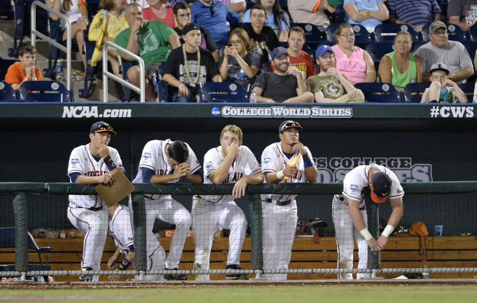 Photo - Virginia players watch as Vanderbilt defeated Virginia 9-8 in the opening game of the best-of-three NCAA baseball College World Series finals in Omaha, Neb., Monday, June 23, 2014. (AP Photo/Ted Kirk)
