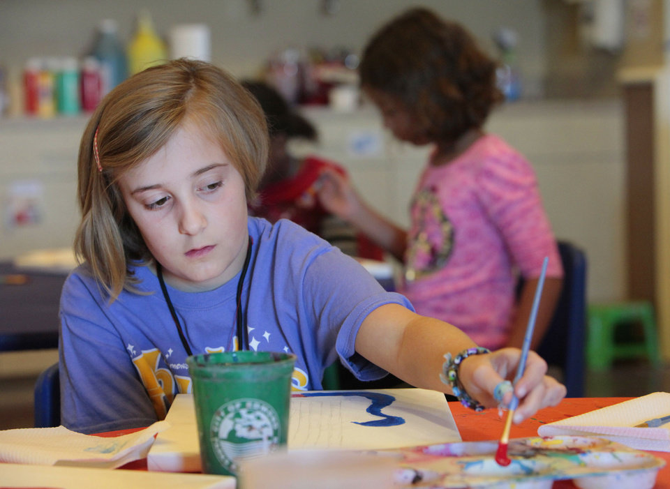 Sophie Minhinnett, 8, starts her painting of a guitar during Edmond Parks and Recreation Department's spring break art camp. PHOTO BY DAVID MCDANIEL, THE OKLAHOMAN. <strong>David McDaniel - The Oklahoman</strong>