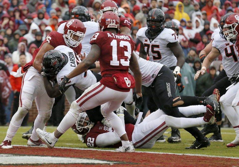 Photo - Oklahoma State's Chris Carson (32) scores a touchdown in the second quarter during the Bedlam college football game between the Oklahoma Sooners (OU) and the Oklahoma State Cowboys (OSU) at Gaylord Family - Oklahoma Memorial Stadium in Norman, Okla., Saturday, Dec. 3, 2016. Photo by Sarah Phipps, The Oklahoman