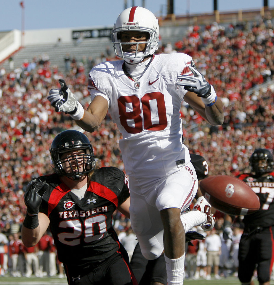 OU's Adron Tennell misses the catch in front of Texas Tech's Bront Bird during the college football game between the University of Oklahoma Sooners (OU) and Texas Tech University Red Raiders (TTU ) at Jones AT&T Stadium in Lubbock, Texas,, Saturday, Nov. 21, 2009. Photo by Bryan Terry, The Oklahoman