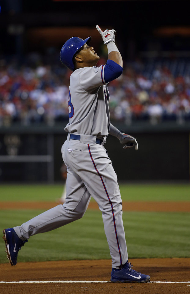 Photo - Chicago Cubs' Starlin Castro reacts as he rounds the bases after hitting a two-run home run off Philadelphia Phillies starting pitcher Roberto Hernandez during the fourth inning of a baseball game, Friday, June 13, 2014, in Philadelphia. (AP Photo/Matt Slocum)
