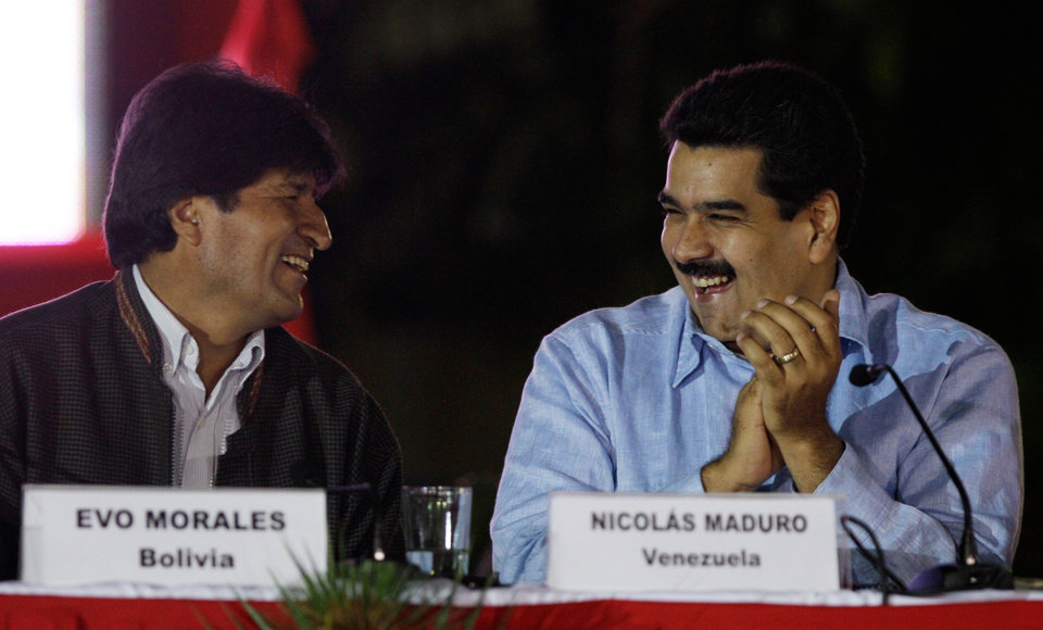 Venezuela's Vice President Nicolas Maduro, right, and Bolivia's President Evo Morales share a laugh during the 8th anniversary of ALBA group in Caracas, Venezuela, Saturday, Dec. 15, 2012. President Hugo Chavez has been receiving daily visits from former Cuban leader Fidel Castro while recovering from cancer surgery in Cuba, a Venezuelan government official said Saturday night. (AP Photo/Fernando Llano)