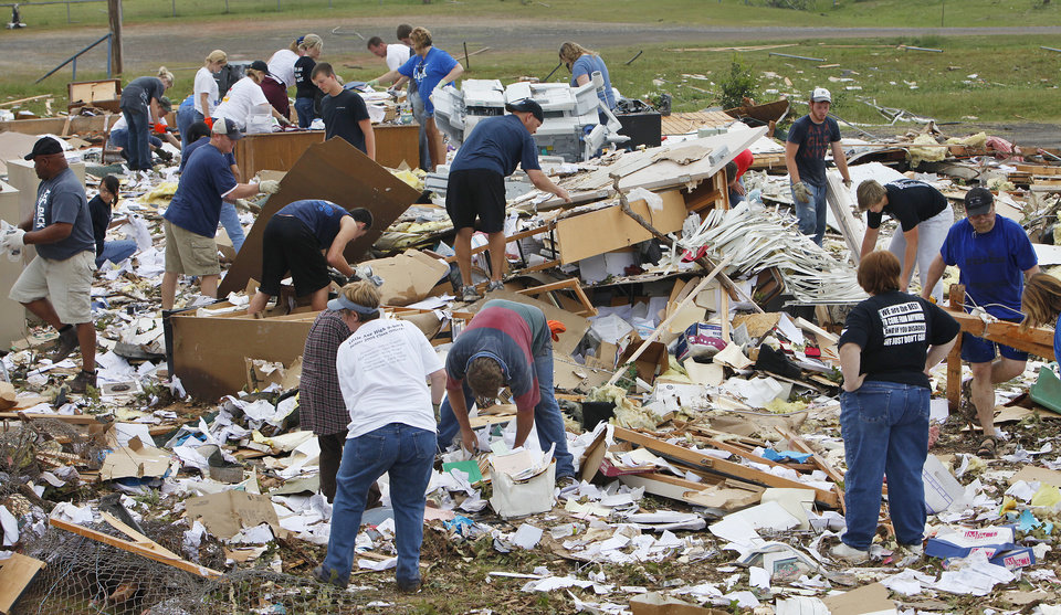 Photo - Students, teachers and administrators sieved through the debris of the Little Axe School Central Office, Tuesday, May 11, 2010. The school was hit by a tornado Monday, May 10, 2010. Photo by David McDaniel, The Oklahoman