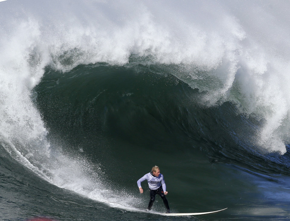 Ryan Augenstein competes during the third heat of the Mavericks Surf Competition in Half Moon Bay, Calif., Sunday, Jan. 20, 2013. (AP Photo/Marcio Jose Sanchez)