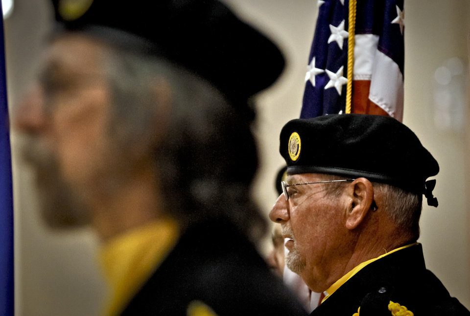 Photo - Members of the Mustang American Legion Honor Guard prepare for the presentation of colors during  Yukon High School's Veterans Day celebration on Monday. Photo by Chris Landsberger, The Oklahoman  CHRIS LANDSBERGER - CHRIS LANDSBERGER