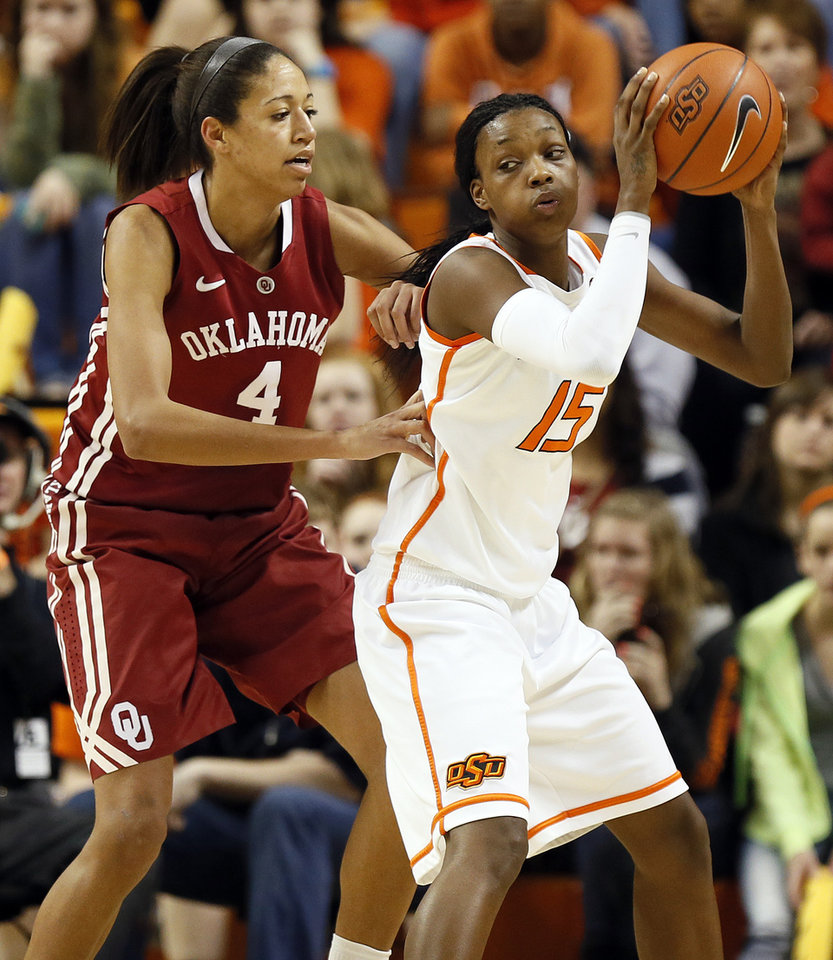 Photo - Oklahoma State's Toni Young (15) works against Oklahoma's Nicole Griffin (4) during the Bedlam women's college basketball game between Oklahoma State University and the University of Oklahoma at Gallagher-Iba Arena in Stillwater, Okla., Saturday, Feb. 23, 2013. OSU beat OU, 83-62. Photo by Nate Billings, The Oklahoman