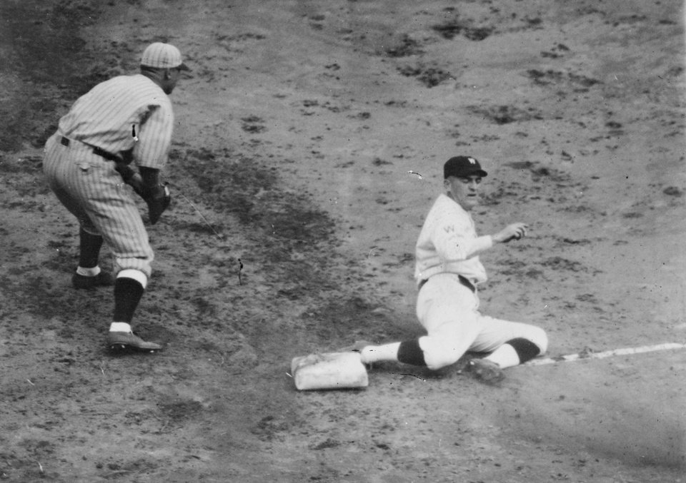 In this Oct. 5, 1924, photo made available by the Library of Congress Senators Joe Judge is safe at 3rd in the 9th inning of the 7th game of the World Series in Washington between the Washington Senators and the New York Giants. Like this year's Washington Nationals, the 1924 World Series champion Washington Senators generated excitement in a city starved for a baseball winner. The Nats will begin their quest for the city's second championship when the playoffs begin this weekend. (AP Photo/Library of Congress)