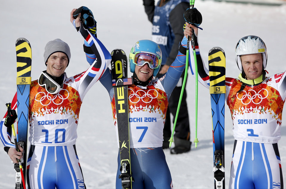 Photo - Men's giant slalom winners, from left, France's Steve Missillier (silver), United States' Ted Ligety (gold) and France's Alexis Pinturault (bronze) pose for photographers at the Sochi 2014 Winter Olympics, Wednesday, Feb. 19, 2014, in Krasnaya Polyana, Russia. (AP Photo/Christophe Ena)