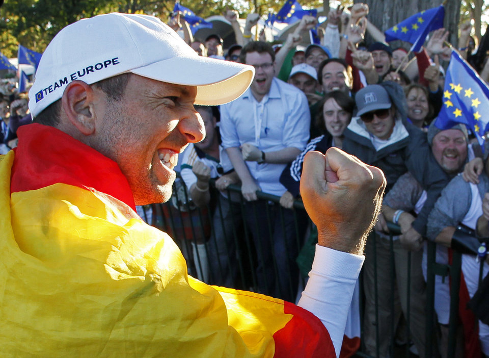 Photo - Europe's Sergio Garcia celebrates after winning the Ryder Cup PGA golf tournament Sunday, Sept. 30, 2012, at the Medinah Country Club in Medinah, Ill. (AP Photo/Charles Rex Arbogast)  ORG XMIT: PGA213