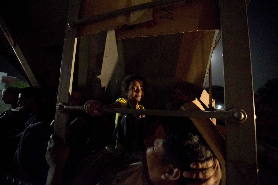 Photo - In this July 11, 2014, photo, Central American migrants ride a freight train during their journey toward the U.S.-Mexico border in Chahuites, Mexico. Many children and teenagers who travelled to the United States recently said they did so after hearing they would be allowed to stay. (AP Photo/Eduardo Verdugo)