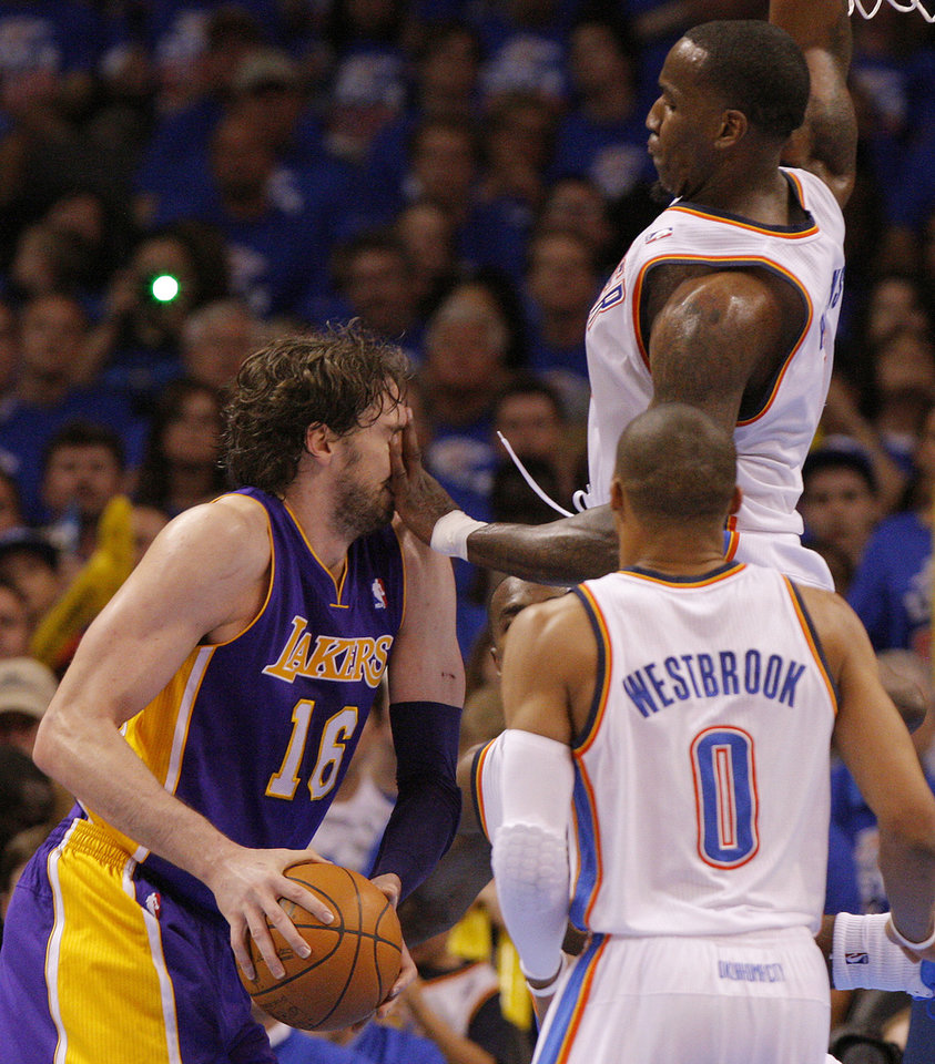 Oklahoma City's Kendrick Perkins (5) fouls Los Angeles' Pau Gasol (16) during Game 5 in the second round of the NBA playoffs between the Oklahoma City Thunder and the L.A. Lakers at Chesapeake Energy Arena in Oklahoma City, Monday, May 21, 2012. Oklahoma City won 106-90.  Photo by Bryan Terry, The Oklahoman