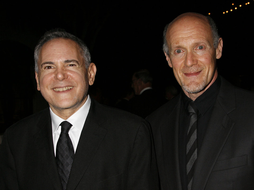 "FILE - This Nov. 15, 2007 file photo shows Craig Zadan, left, and Neil Meron, producers of the film ""Hairspray"" at the Santa Barbara International Film Festival's in Santa Barbara, Calif. Academy Awards producers Zadan and Meron announced Monday, Feb. 11, 2013, that Renee Zellweger, Catherine Zeta Jones, Queen Latifah and Richard Gere will return to the stage where �Chicago� won best picture in 2003. Zadan and Meron also produced the film. The 85th annual Academy Awards will be presented Feb. 24, 2013, at the Dolby Theatre and broadcast live on ABC.  (AP Photo/Michael A. Mariant, File)"