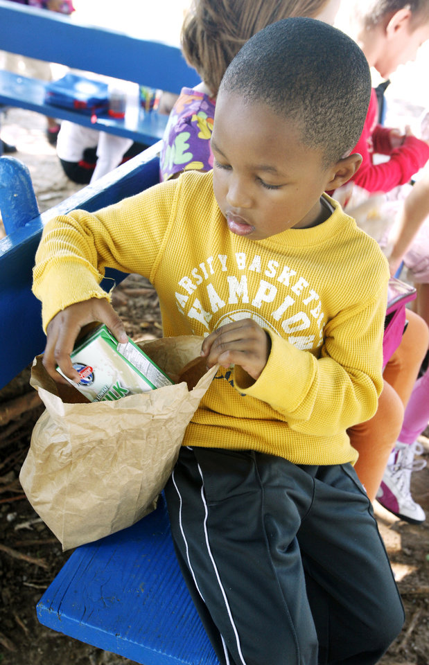 Trae Henderson, 6, unpacks a lunch at the North Side YMCA during the first week of fall break in Oklahoma City Public Schools. PHOTO BY PAUL B. SOUTHERLAND, THE OKLAHOMAN