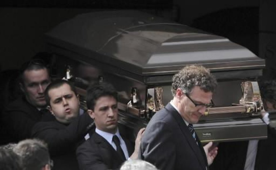 Photo - Pallbearers carry the coffin of Christopher Lane to the funeral hearse at St. Therese's Church in Melbourne, Australia, Wednesday, Aug. 28, 2012. Lane died Aug. 16 in Duncan, Oklahoma, and police say three teenagers targeted him at random to break up the monotony of an Oklahoma summer. (AP Photo/AAP Image, Julian Smith)