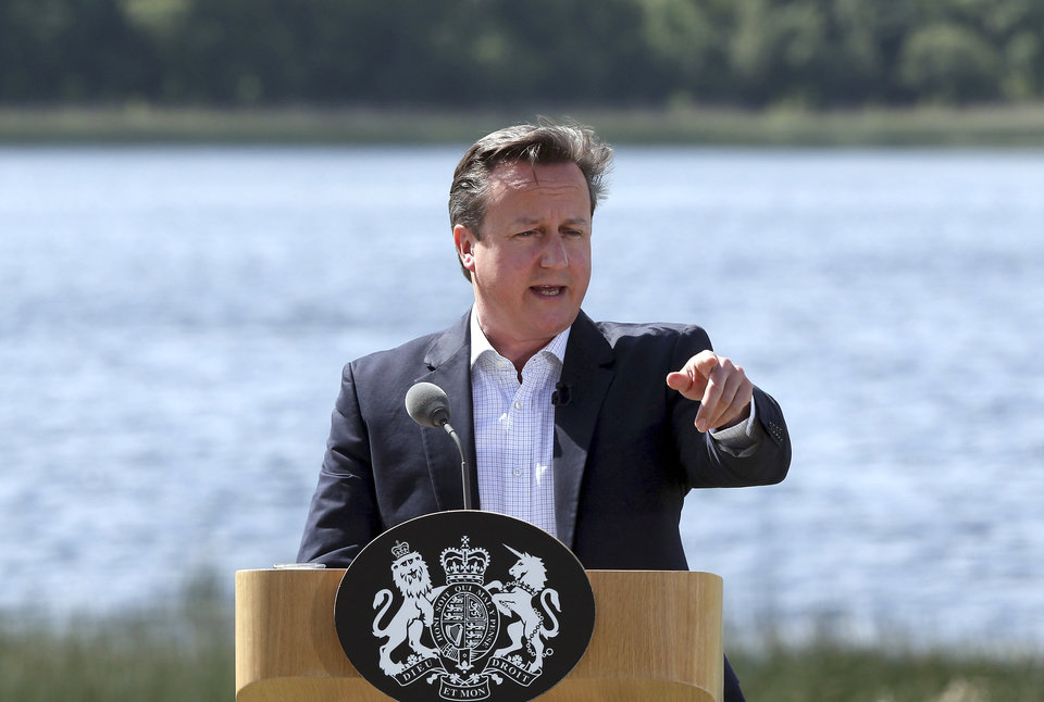 Photo - British Prime Minister David Cameron speaks during a media conference at the G-8 summit at the Lough Erne golf resort in Enniskillen, Northern Ireland, on Tuesday, June 18, 2013. The final day of the G-8 summit of wealthy nations is ending with discussions on globe-trotting corporate tax dodgers, a lunch with leaders from Africa, and suspense over whether Russia and Western leaders can avoid diplomatic fireworks over their deadlock on Syria's civil war. (AP Photo/Matt Cardy, Pool)