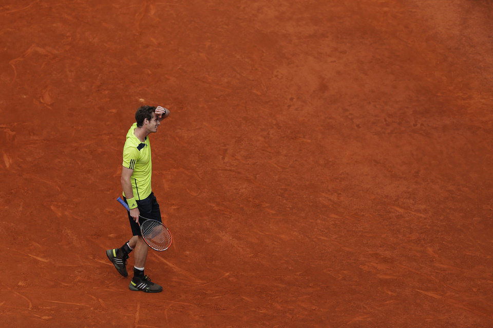 Photo - Andy Murray from Britain reacts during a Madrid Open tennis tournament match against Santiago Giraldo from Colombia in Madrid, Spain, Thursday, May 8, 2014. (AP Photo/Andres Kudacki)