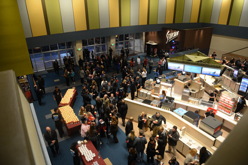 Photo - Guests fill the lobby of the Century Aurora cinema, formerly the Century 16, for a reopening and remembrance ceremony Thursday, Jan. 17, 2013 in Aurora, Colo. The theater is where 12 people were killed and dozens injured in a shooting rampage last July. (AP Photo/The Denver Post, RJ Sangosti, Pool)