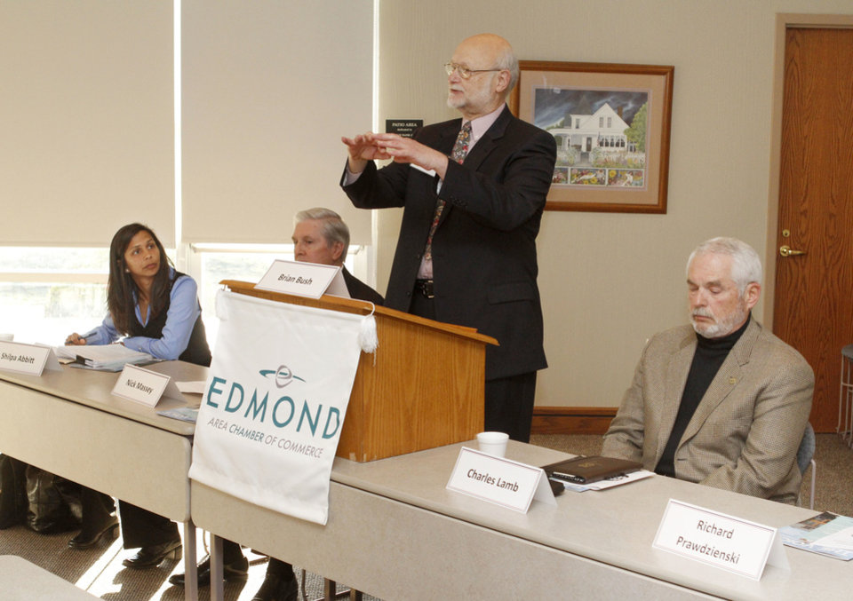 Photo - Edmond mayoral candidate Richard Prawdzienski speaks during a candidate forum at the Edmond Area  Chamber of Commerce. Other candidates, from left, are Shilpa Abbitt, Nick Massey and Charles Lamb.  PHOTO BY PAUL HELLSTERN, THE OKLAHOMAN