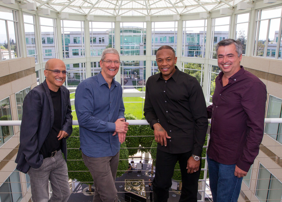 Photo - In this image provided by Apple, from left to right, music entrepreneur and Beats co-founder Jimmy Iovine, Apple CEO Tim Cook, Beats co-founder Dr. Dre, and Apple senior vice president Eddy Cue pose together at Apple headquarters in Cupertino, Calif., Wednesday, May 28, 2014. Apple is striking a new chord with a $3 billion acquisition of Beats Electronics, a headphone and music streaming specialist that also brings the swagger of rapper Dr. Dre and recording impresario Jimmy Iovine. The announcement on Wednesday comes nearly three weeks after deal negotiations were leaked to the media. (AP Photo/Apple, Paul Sakuma)