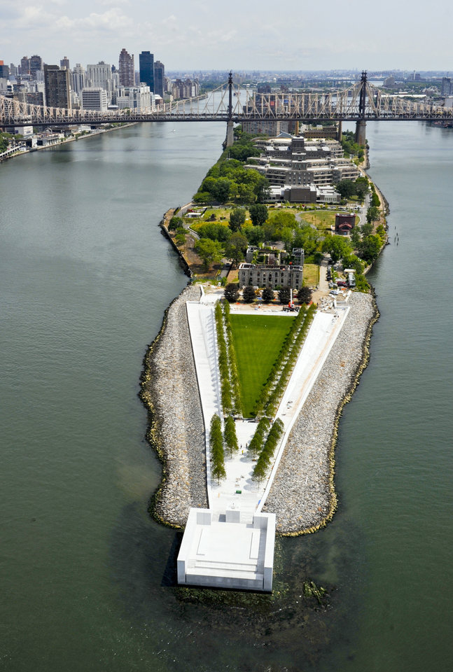 Photo -   This July 11, 2012 photo provided by FDR Four Freedoms Park LLC, shows an arial view of the New York City memorial park, honoring President Franklin D. Roosevelt, that has been completed 40 years after the original design was created. The Franklin D. Roosevelt Four Freedoms Park on the southern tip of 2-mile-long Roosevelt Island - between Manhattan and Queens - is being dedicated Wednesday, Oct. 17, 2012, in a ceremony to be attended by dignitaries including former President Bill Clinton and Mayor Michael Bloomberg. (AP Photo/FDR Four Freedoms Park LLC, Steve Amiaga - www.amiaga.com)