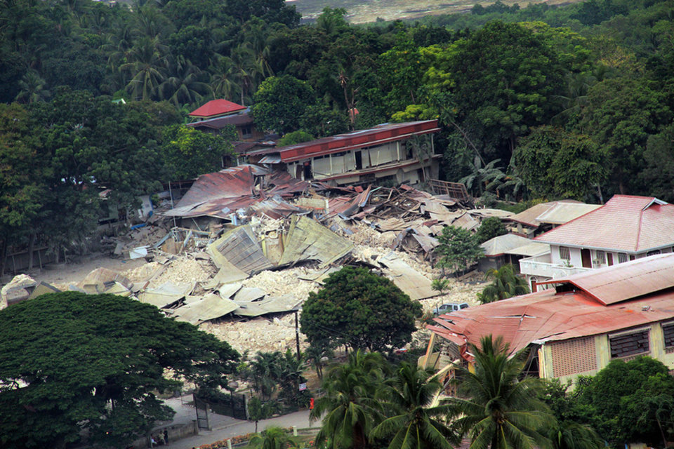 Photo - In this photo released by the Philippine Air Force shows damaged structures and part of the Our Lady of Light Catholic church after a powerful earthquake struck Loon town, Bohol province, central Philippines Wednesday Oct. 16, 2013. The 7.2-magnitude earthquake that struck the central Philippines and killed more than a hundred people also dealt a serious blow to the region's historical and religious legacy by heavily damaging a dozen or more churches, some of them hundreds of years old. (AP Photo/ Philippine Air Force)