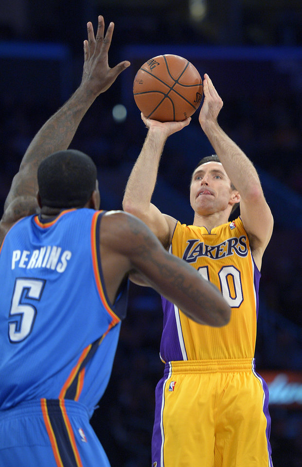 Photo - Los Angeles Lakers guard Steve Nash, right, shoots over Oklahoma City Thunder center Kendrick Perkins during the first half of their NBA basketball game, Friday, Jan. 11, 2013, in Los Angeles. (AP Photo/Mark J. Terrill)