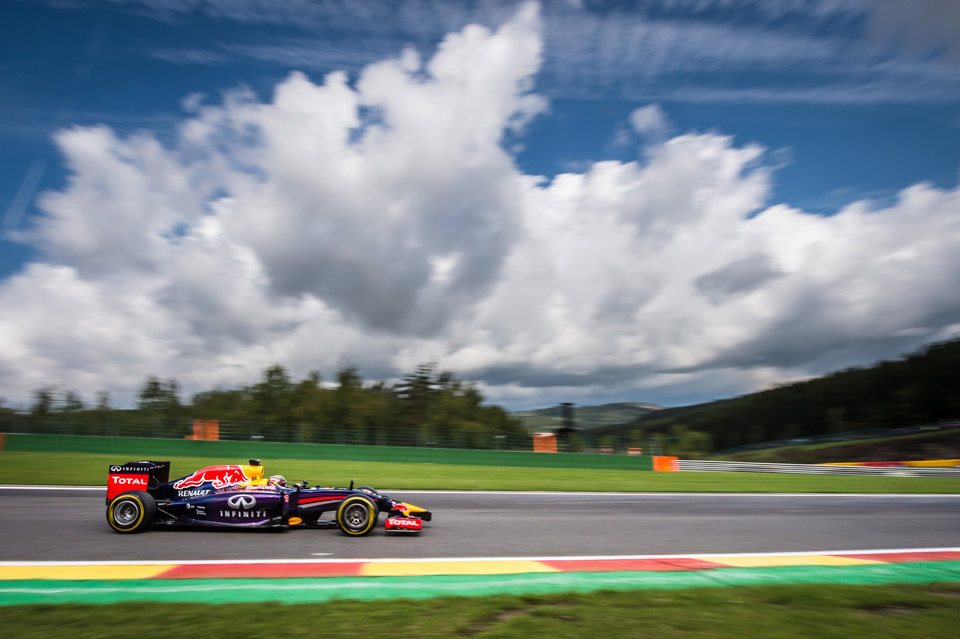 Photo - Red Bull driver Sebastian Vettel of Germany steers his car during the third practice session ahead of Sunday's Belgian Formula One Grand Prix in Spa-Francorchamps, Belgium, Saturday, Aug. 23, 2014. (AP Photo/Geert Vanden Wijngaert)