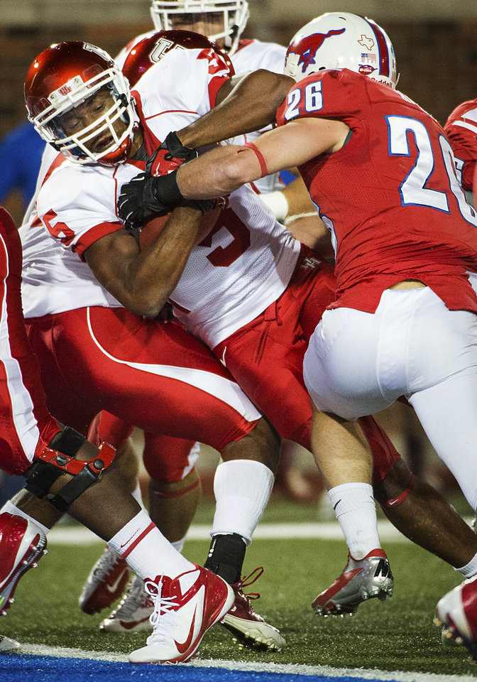 Photo -   Houston running back Charles Sims (5) rushes for a 1-yard touchdown against SMU defensive back Brett Haness (26) during the first quarter of an NCAA college football game, Thursday, Oct. 18, 2012, in Dallas. (AP Photo/Houston Chronicle, Smiley N. Pool) MANDATORY CREDIT