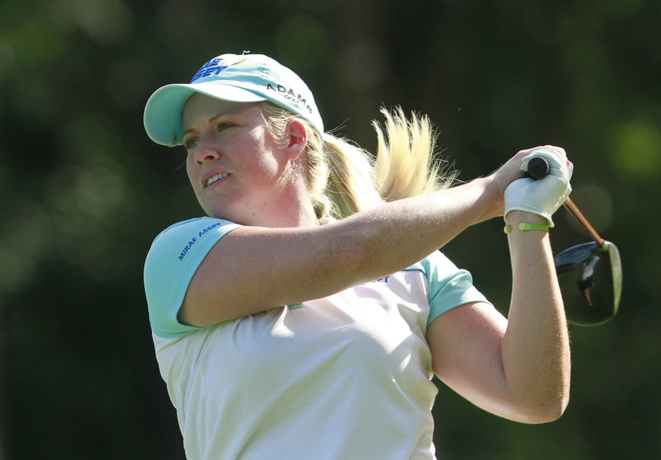 Photo -   Brittany Lincicome tees off on the 18th green during the third round of the Mobile Bay LPGA Classic golf tournament, Saturday, April 28, 2012, in Mobile, Ala. (AP Photo/Press-Register, Bill Starling) MAGS OUT