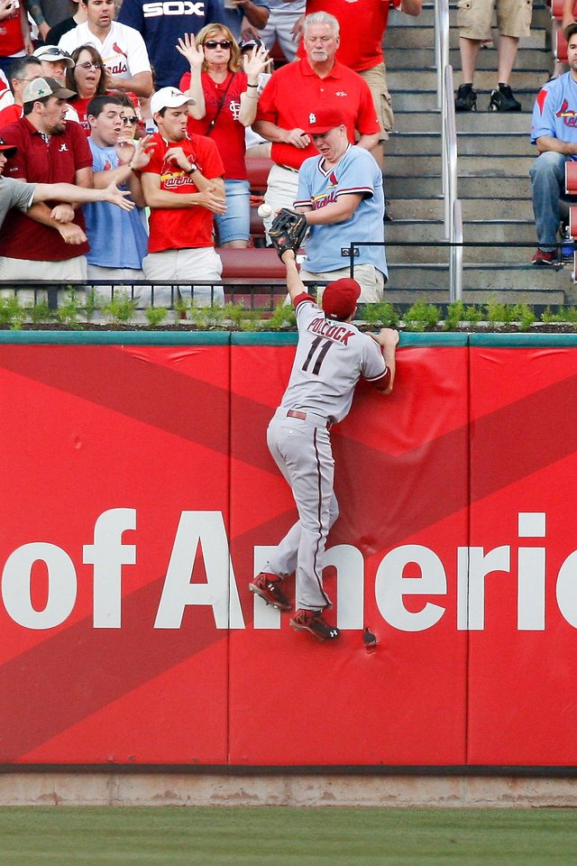 Photo - Arizona Diamondbacks center fielder A.J. Pollock  is unable to catch a  home run off the bat of St. Louis Cardinals' Matt Adams during the first inning of a baseball game Tuesday, May 20, 2014, in St. Louis. (AP Photo/Scott Kane)