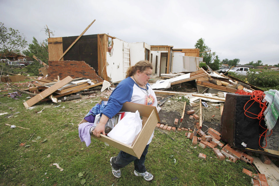 Holly Starkey gathers her belongings Tuesday from her home in Tecumseh. PHOTO BY Steve Gooch, The Oklahoman