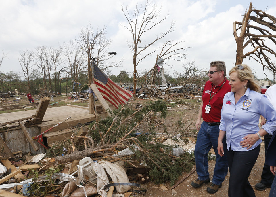 Photo - Oklahoma Gov. Mary Fallin, right, walks through the Steelman Estates Mobile Home Park, which was hard hit in Sunday's tornado, with Albert Ashwood, left, Director of the Oklahoma Department of Emergency Management, near Shawnee, Okla., Monday, May 20, 2013. (AP Photo Sue Ogrocki)